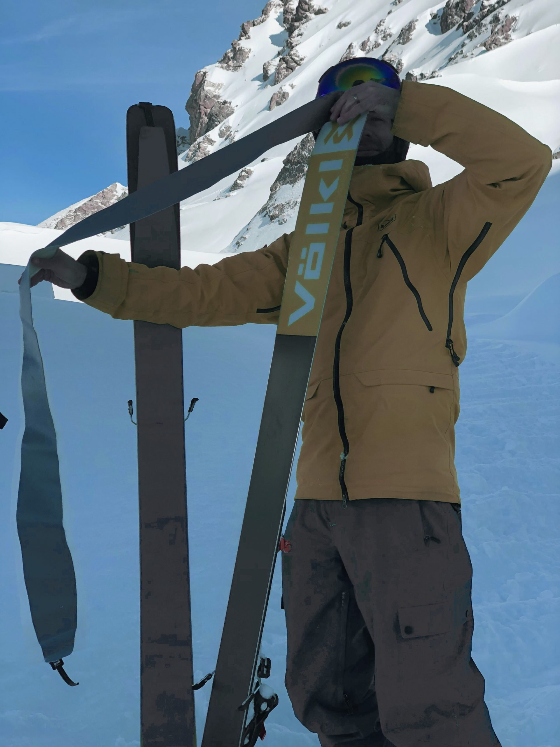 Touring skiing putting on skins off piste